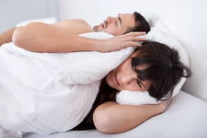 Snoring can be a symptom of sleep apnea.